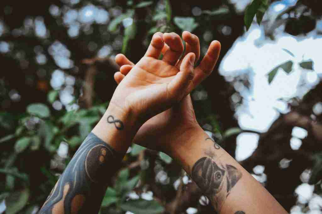 tattoos on forearms photo by matheus ferrero from pexels