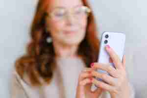 blur of woman looking at cell photo by anna shvets from pexels