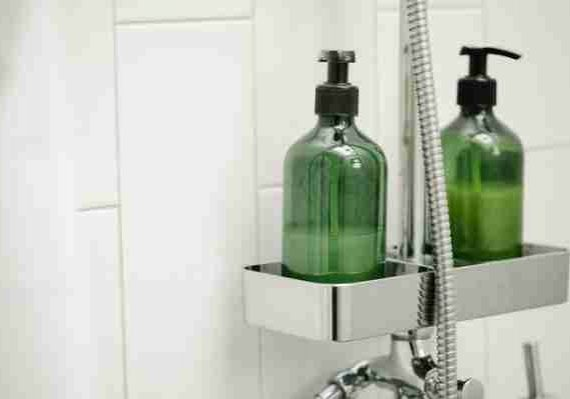 shampoo bottles in shower stall shampoo and soap in eyes